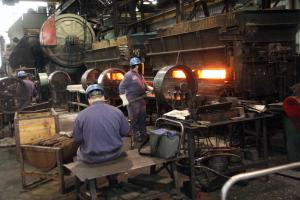 Men working in the forge shop